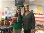 Southport Elementary's Kat Adams accepts the March 27 Game Ball