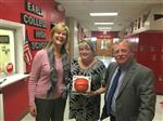 Kathrine Weeks receives MVP game ball from Dr. Meadows and Mr. Tubb