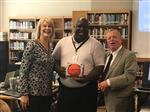 Mr. Paul Hewett receives Game Ball from Dr. Meadows and Mr. Tubb