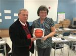 Cathy Johnson receives March 13 MVP Game Ball from Superintendent Les Tubb.